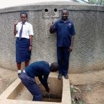 The Water Project: Essaba Secondary School -  Alice And Andeyo With Kipchoge At The Rain Tank