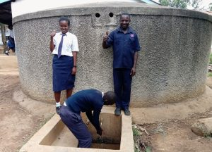 The Water Project:  Alice And Andeyo With Kipchoge At The Rain Tank
