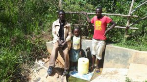 The Water Project:  Community Member With Dorine And Kevin