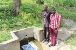 The Water Project:  Communtiy Member With Jonathan At The Spring