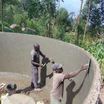 The Water Project: Kapchorwa Primary School -  Cementing Inside Of Tank Walls