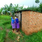 The Water Project: Kapkures Primary School -  Girls In Line At Latrines