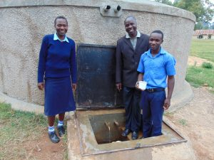 The Water Project:  Rebecca Mr Luvembe And Another Student At The Rain Tank