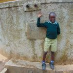 The Water Project: Shitaho Primary School -  Student At Rain Tank