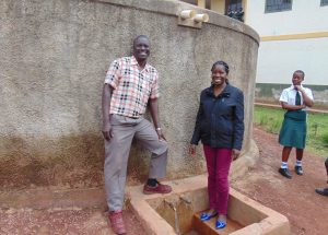The Water Project:  Mr Muchesia And Field Officer Christine Masinde