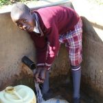 The Water Project: Emulakha Community, Alukoye Spring -  Boy At Spring