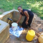 The Water Project: Mbande Community, Handa Spring -  Woman Filling Up