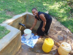 The Water Project:  Woman Filling Up