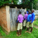 The Water Project: Kapkures Primary School -  Boys In Line At Latrines