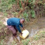 The Water Project: Sambaka Community, Sambaka Spring -  Fetching Water