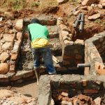 The Water Project: Mutao Community, Kenya Spring -  Working On The Stairs