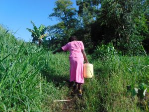 The Water Project:  Grace Carries Water Home