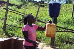 The Water Project:  Purifying Spring Water Using Chlorine Dispenser
