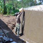 The Water Project: Kapchorwa Primary School -  Working On Tank Dome And Walls