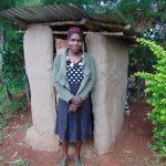 The Water Project: Namarambi Community, Iddi Spring -  Woman Outside Latrine