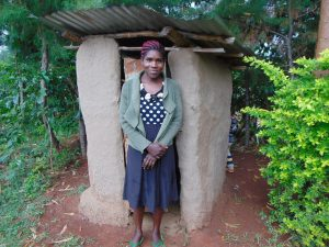 The Water Project:  Woman Outside Latrine