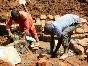 The Water Project:  Adding The Discharge Pipe