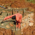 The Water Project: Mutao Community, Kenya Spring -  Finishing The Rub Wall