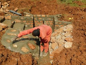 The Water Project:  Finishing The Rub Wall