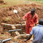 The Water Project: Mutao Community, Kenya Spring -  Pipe Setting