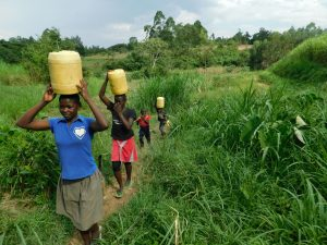 The Water Project:  Children Carrying Water Home