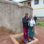 The Water Project: Kwirenyi Secondary School -  Field Officer Christine With Nicorine Shitamu