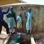 The Water Project: Shitaho Primary School -  Students And Staff At Rain Tank