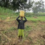 The Water Project: Sambaka Community, Sambaka Spring -  Carrying Water Home