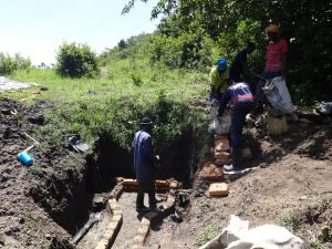 The Water Project:  Women Deliver Cement