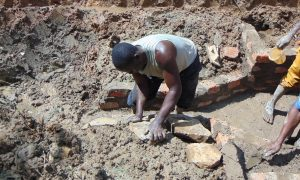 The Water Project:  Setting Stones For The Rub Wall