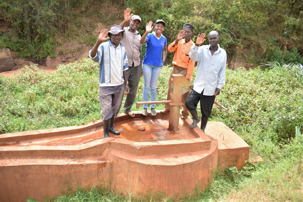 The Water Project : kenya18169-field-officer-kendi-with-community-members