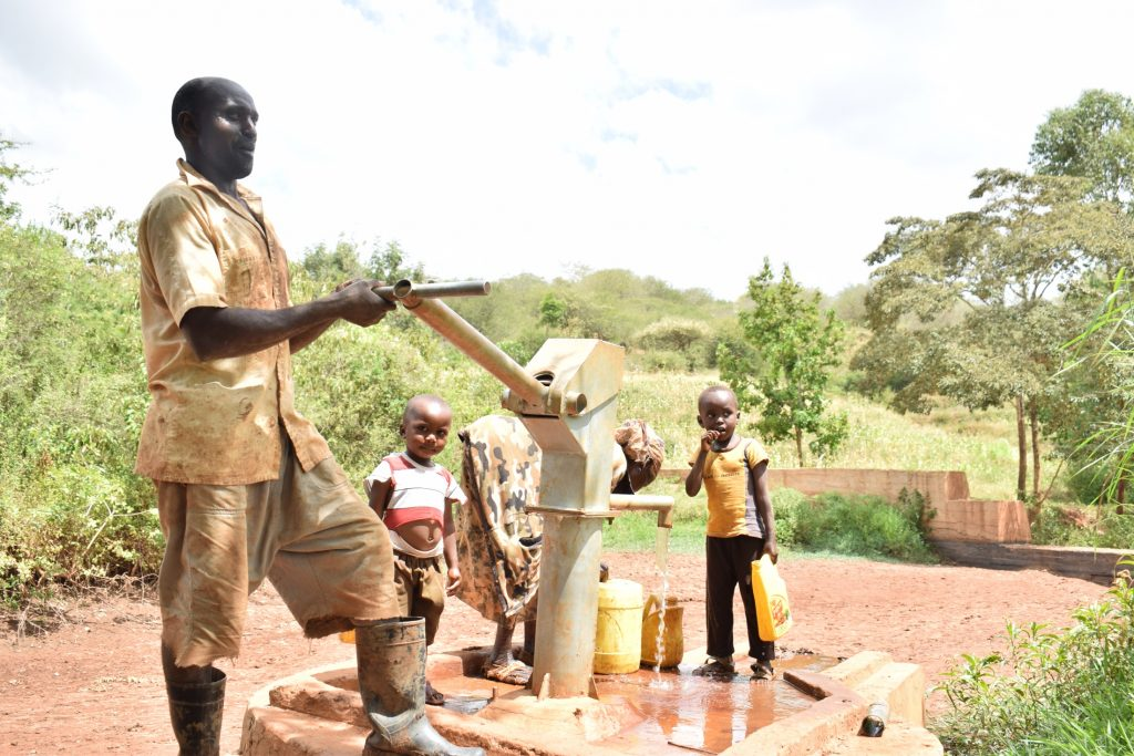 The Water Project : kenya18170-pumping-the-well