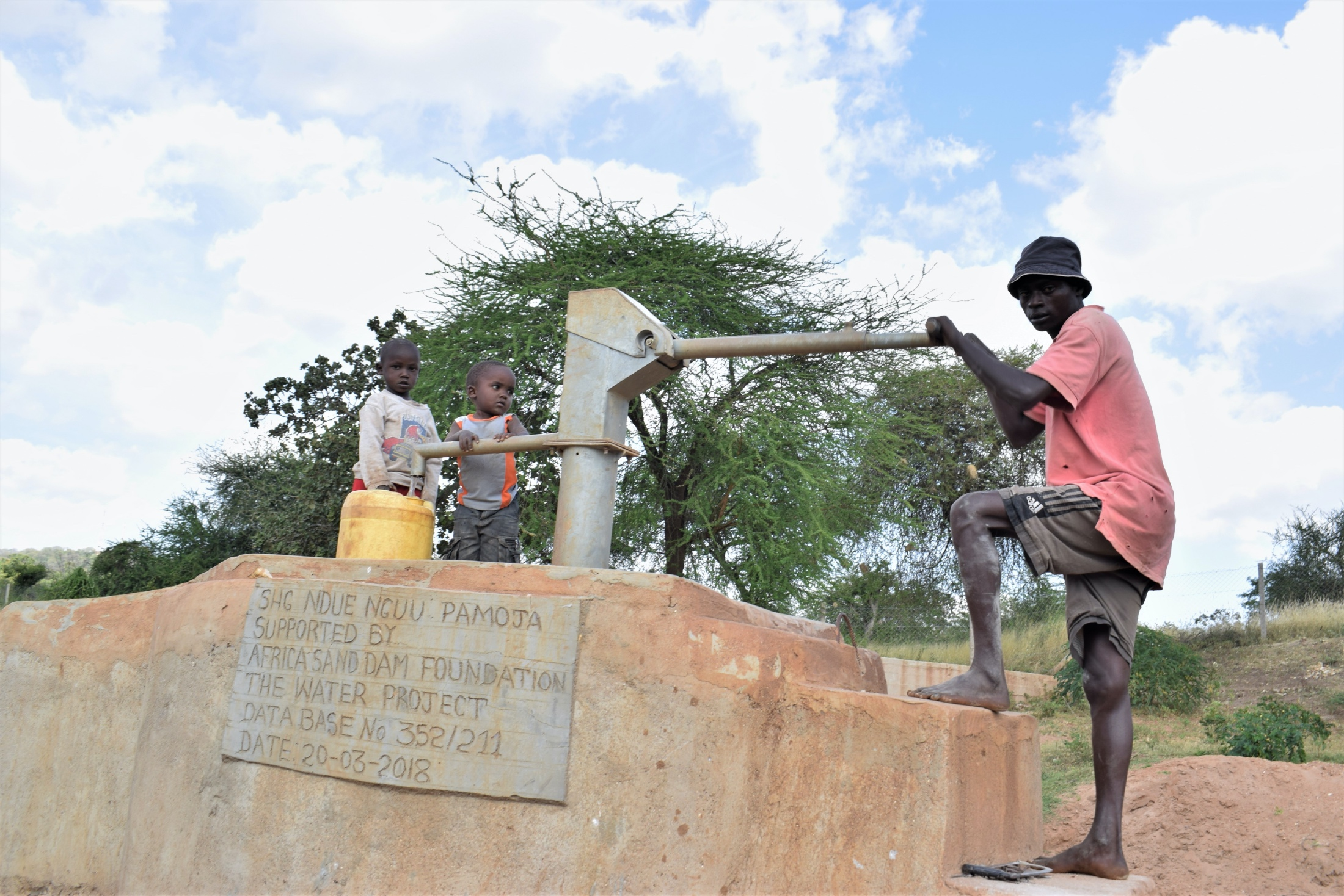 The Water Project : kenya18173-filling-up-jerrycan-with-water