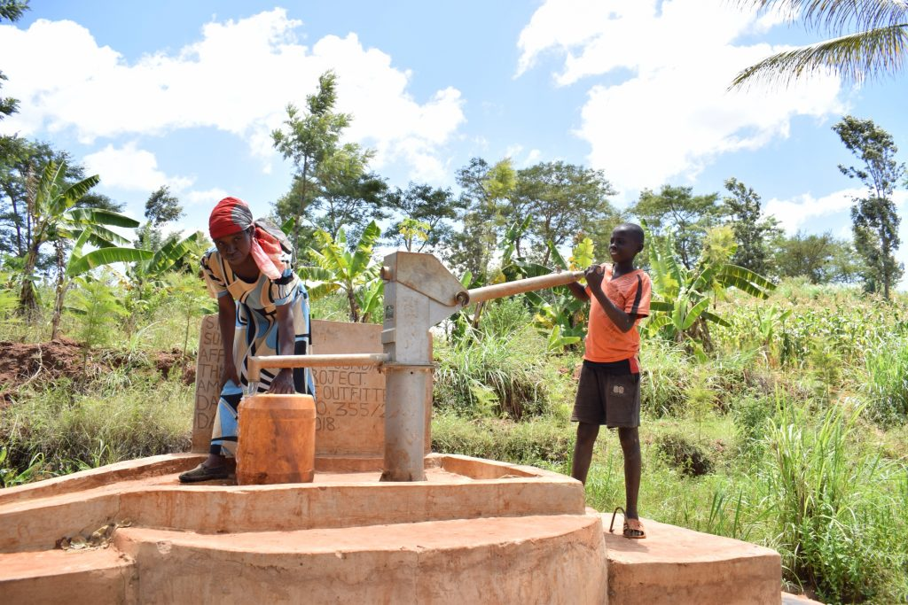 The Water Project : kenya18175-filling-container-at-the-well