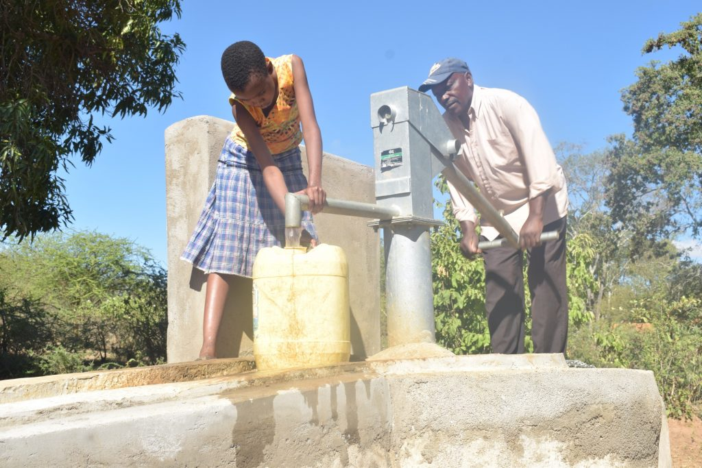 The Water Project : kenya18176-filling-container-at-the-well