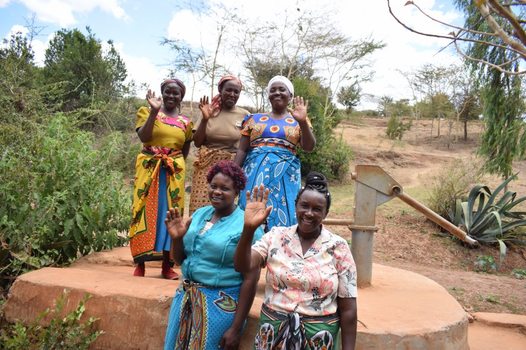The Water Project : kenya18180-happy-community-members-at-the-well