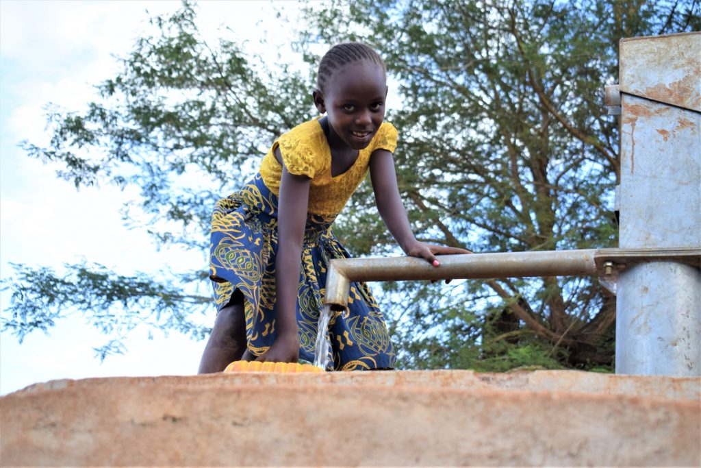 The Water Project : kenya18183-filling-up-container-at-the-well