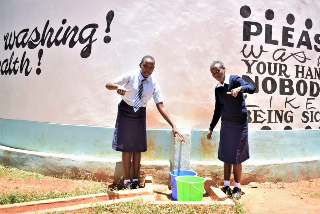 The Water Project : kenya18230-filling-containers-with-water