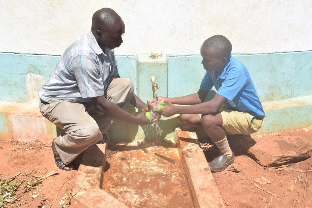 The Water Project : kenya18235-filling-up-cups-with-water