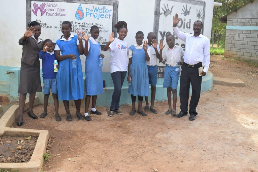 The Water Project : kenya18239-our-field-officer-with-some-of-the-students-and-staff-at-the-tank