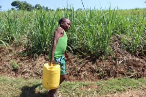 The Water Project:  Child Hauling Water