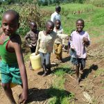 The Water Project: Kalenda A Community, Webo Simali Spring -  Children Coming From The Spring