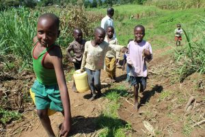 The Water Project:  Children Coming From The Spring