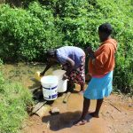 The Water Project: Kalenda A Community, Webo Simali Spring -  Filling Containers With Water