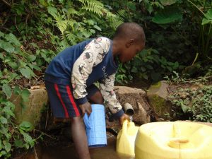 The Water Project:  A Child Fetching Water At The Unprotected Spring