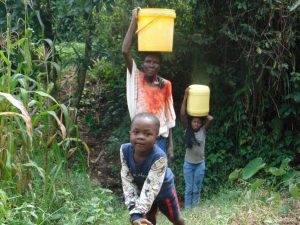 The Water Project:  A Family Carrying Water From The Spring