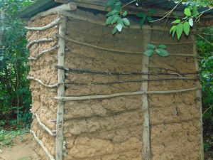 The Water Project:  A Latrine With Mud Walls