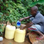The Water Project: Mubinga Community, Mulutondo Spring -  Filling Containers With Water