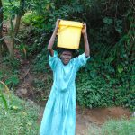 The Water Project: Mubinga Community, Mulutondo Spring -  Water Loaded On Her Head