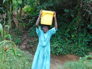 The Water Project:  Water Loaded On Her Head